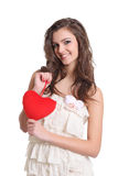 Cute girl smiling with a red heart sign Royalty Free Stock Photography