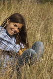 Cute girl smiling in tall grass Stock Photos