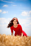 Cute girl in smiling woman in white dress in field Stock Photography
