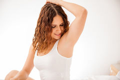 Cute girl with smooth armpits. Pretty young brunette showing off her smooth and hair free armpits after hair removal Royalty Free Stock Images