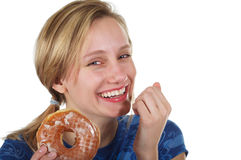 Cute girl sneaking a donut Stock Photography