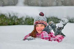 Cute girl in snow Stock Photo