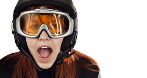 Cute girl with snowboarding helmet and goggles. Cute girl with red hair wearing a ski helmet and orange goggles acting surprised and yelling. Feeling cold royalty free stock photos