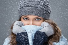 Cute girl with snowflakes having a good time Stock Image