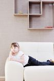 Cute girl on sofa at hoe Royalty Free Stock Photo