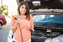 Cute girl with some car trouble Royalty Free Stock Image