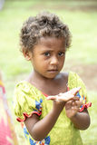 Cute Girl in the South Sea gets Gift from Tourists Royalty Free Stock Photo