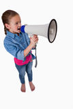 A cute girl speaking through a megaphone Stock Photos
