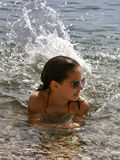 Cute girl splashes in the sea Royalty Free Stock Image
