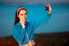 Cute Girl In Sportswear Outfit Taking a Selfie Royalty Free Stock Photos