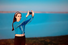 Cute Girl In Sportswear Outfit Taking a Selfie Royalty Free Stock Image
