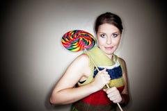 Cute Girl in Spotlight with Lollipop Stock Photos
