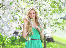 Cute girl in a spring day. In floral garden Royalty Free Stock Photos