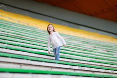 Cute girl on a stadium Royalty Free Stock Image