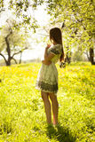 Cute girl standing in the garden Royalty Free Stock Photo