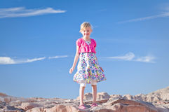 Cute Girl Standing In A Desert Stock Photo