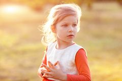 Cute girl standing on lawn Royalty Free Stock Photography