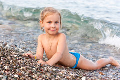 Cute girl standing at the seashore Royalty Free Stock Photography