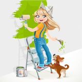 Cute girl standing on a stepladder with a paint roller Stock Image