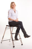 Cute girl on a stepladder Royalty Free Stock Images