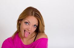 Cute girl sticking tongue to show tongue piercing Stock Image