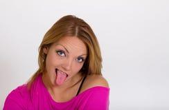 Cute girl sticking tongue to show tongue piercing. Funny sexy expressive girl sticking tongue to show tongue piercing Stock Image