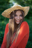 Cute girl in a straw hat Stock Image