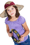 Cute girl with straw hat and tambourine Royalty Free Stock Image