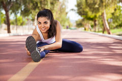 Cute girl stretching outdoors Royalty Free Stock Image