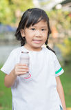 Cute girl student enjoy to drink milk. Royalty Free Stock Photo