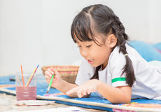 Cute girl student enjoy to paint color Royalty Free Stock Photos