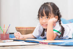 Cute girl student enjoy to paint color Stock Photo