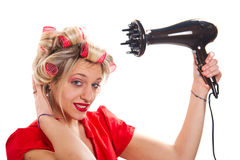 Cute girl styling hair Royalty Free Stock Photos