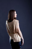 Cute girl in stylish clothes posing back to camera. Close-up Stock Photos