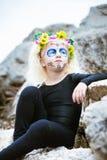 Cute girl with sugar skull makeup Stock Image