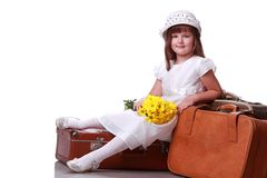 Cute girl on the suitcase Royalty Free Stock Photography