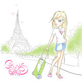Cute girl with a suitcase on background of the Eiffel tower. Stock Photos
