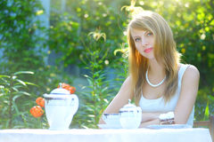 Cute girl in summer cafe Stock Photography
