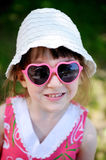 Cute girl in sun glasses Stock Photos