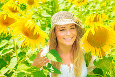 Cute girl in sunflower field Royalty Free Stock Photos