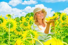 Cute girl in sunflower field Stock Images