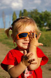Cute girl and sunglasses Stock Images