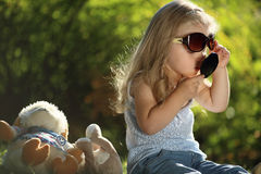 Cute girl with sunglasses outdoors Stock Images