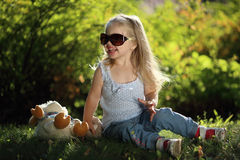 Cute girl with sunglasses outdoors Royalty Free Stock Photography