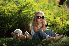 Cute girl with sunglasses outdoors Stock Photo