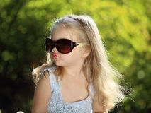 Cute girl with sunglasses outdoors Royalty Free Stock Photos