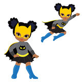 Cute Girl superhero in flight and in standing position. Stock Photography