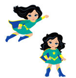 Cute Girl superhero in flight and in standing position. Royalty Free Stock Photography