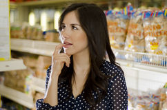 Cute girl at the supermarket Stock Photos