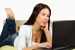 Cute girl, surfing the internet Royalty Free Stock Photos